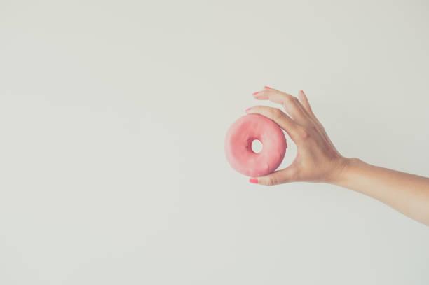Hand holding donut stock photo