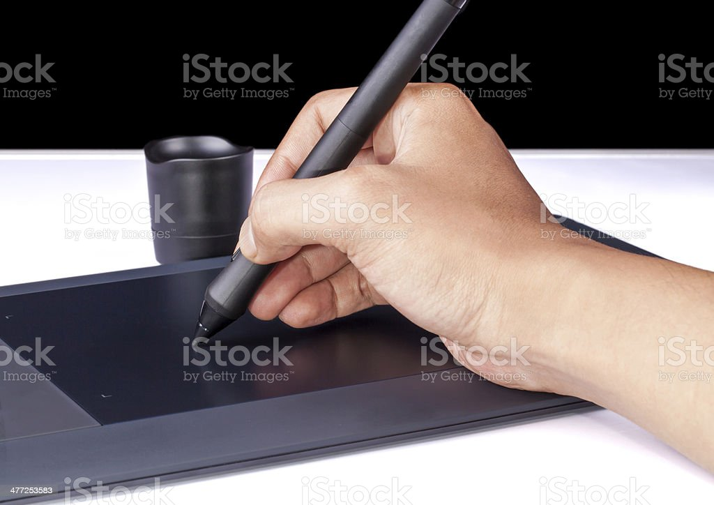 Hand holding Drawing Tablet for Graphic Designer stock photo