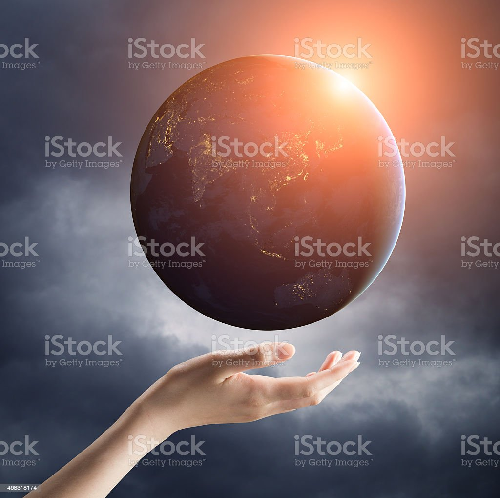 hand holding earth planet on a palm stock photo