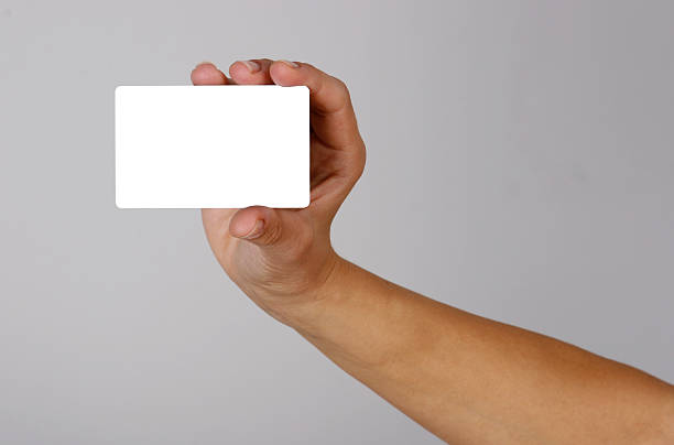 Hand holding empty credit card stock photo
