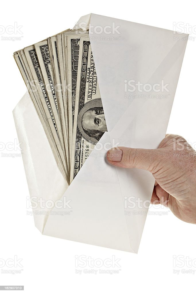 Hand holding envelope full of cash. royalty-free stock photo
