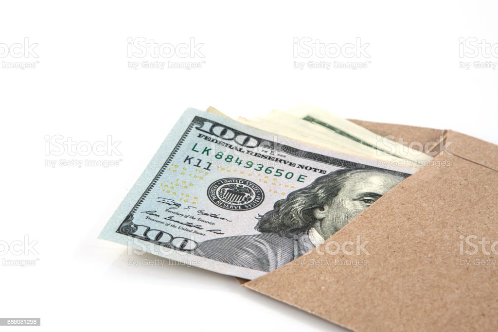 Hand holding envelope  of cash stock photo