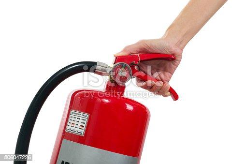 Hand holding fire extinguisher isolated white background.