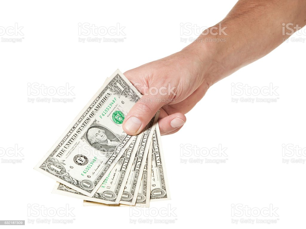 Hand holding Five Dollar bills stock photo
