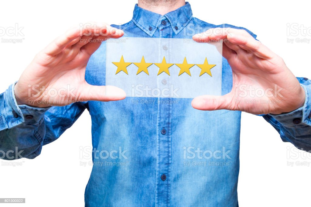 Hand holding five stars rating in his hands, representing business rating. Business concept. White background. Stock Photo stock photo