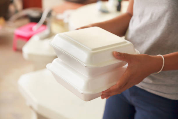 Hand holding foam boxes rice. stock photo