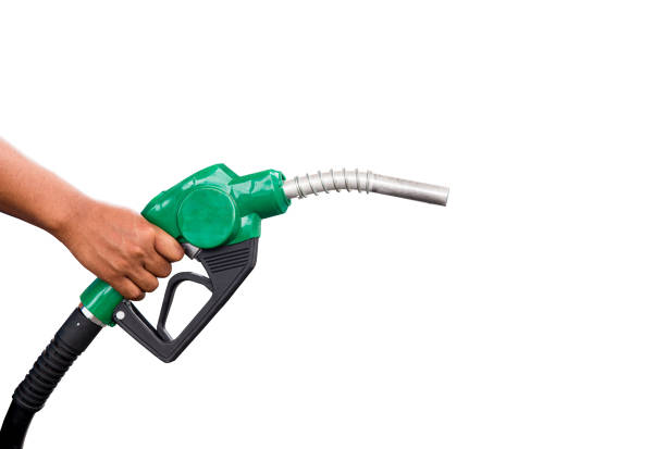 Hand holding gas nozzle with one last drop. A man holding a green gasoline nozzle on a white background. hands of men who were holding an automatic nozzle to make refill oil. Hand holding gas nozzle with one last drop. A man holding a green gasoline nozzle on a white background. hands of men who were holding an automatic nozzle to make refill oil. last stock pictures, royalty-free photos & images