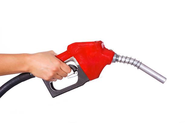 Hand holding gas pump Profile stock photo
