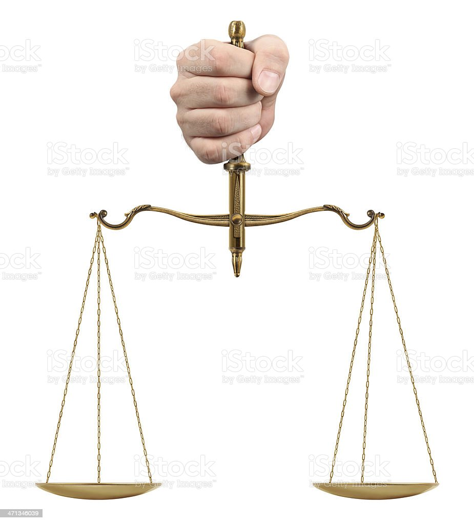 Hand holding gold scales on white background stock photo