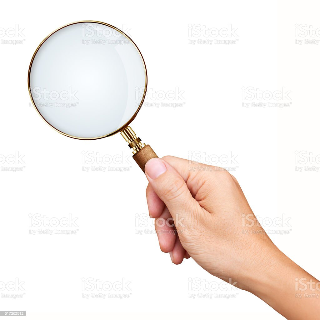Hand holding golden magnifying glass isolated on white backgroun stock photo