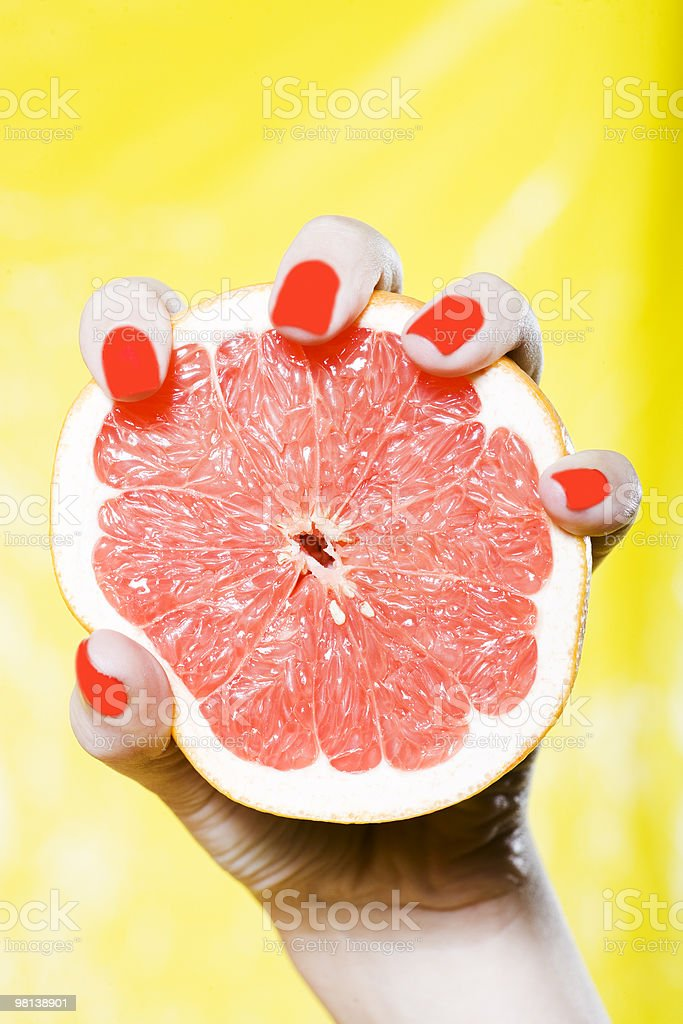 hand holding grapefruit juice royalty-free stock photo