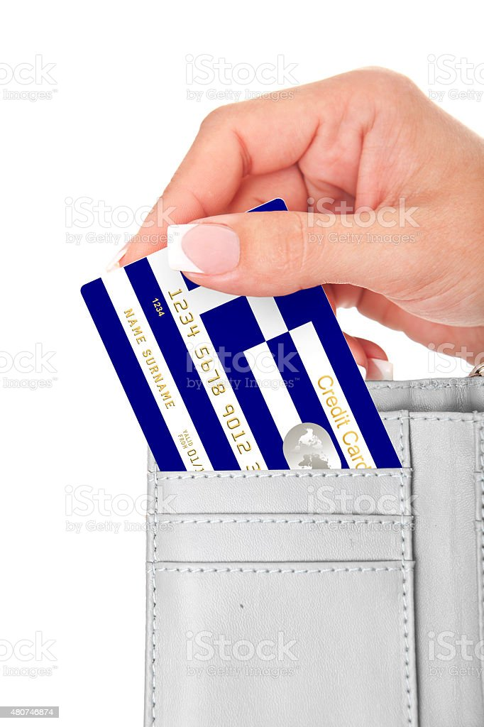hand holding greek credit card in wallet isolated over white stock photo