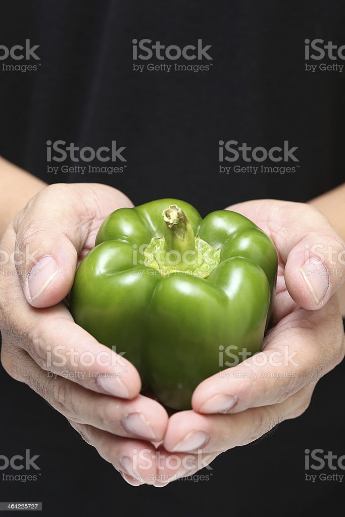 Hand holding green peppers stock photo