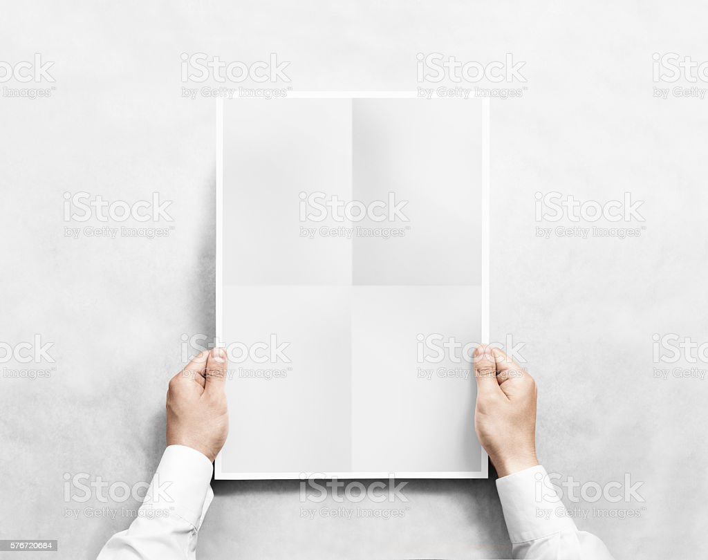 Hand holding grey blank poster mockup, isolated. stock photo