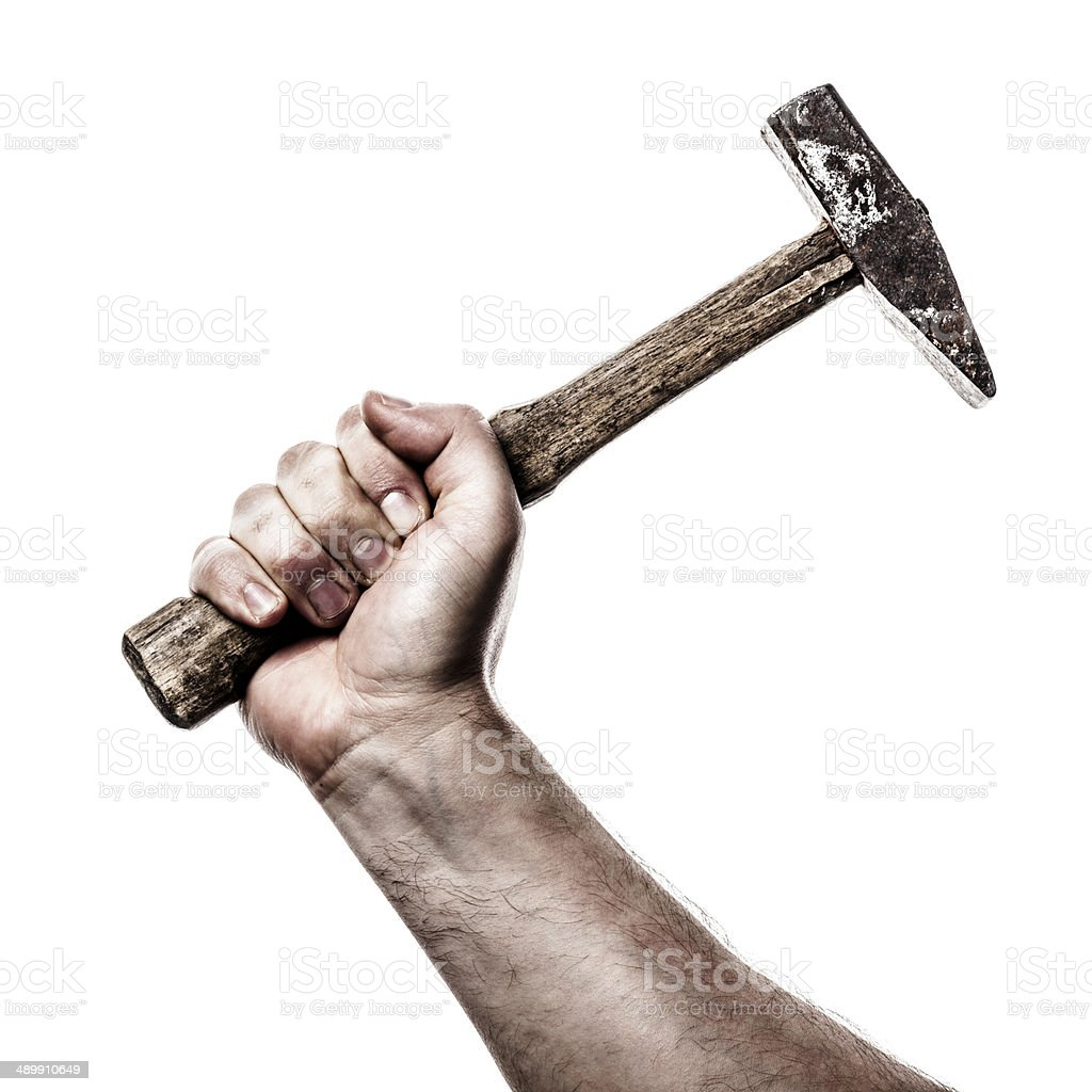 Hand holding hammer stock photo