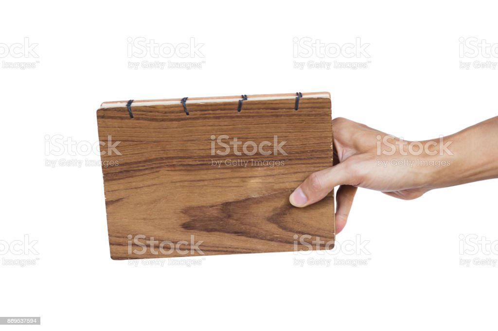 Hand holding hand made book isolated on white background. Clipping path.  Hand made book is beautiful to use for everyone because it looks great to write. Use for writing notes or writing diary. stock photo