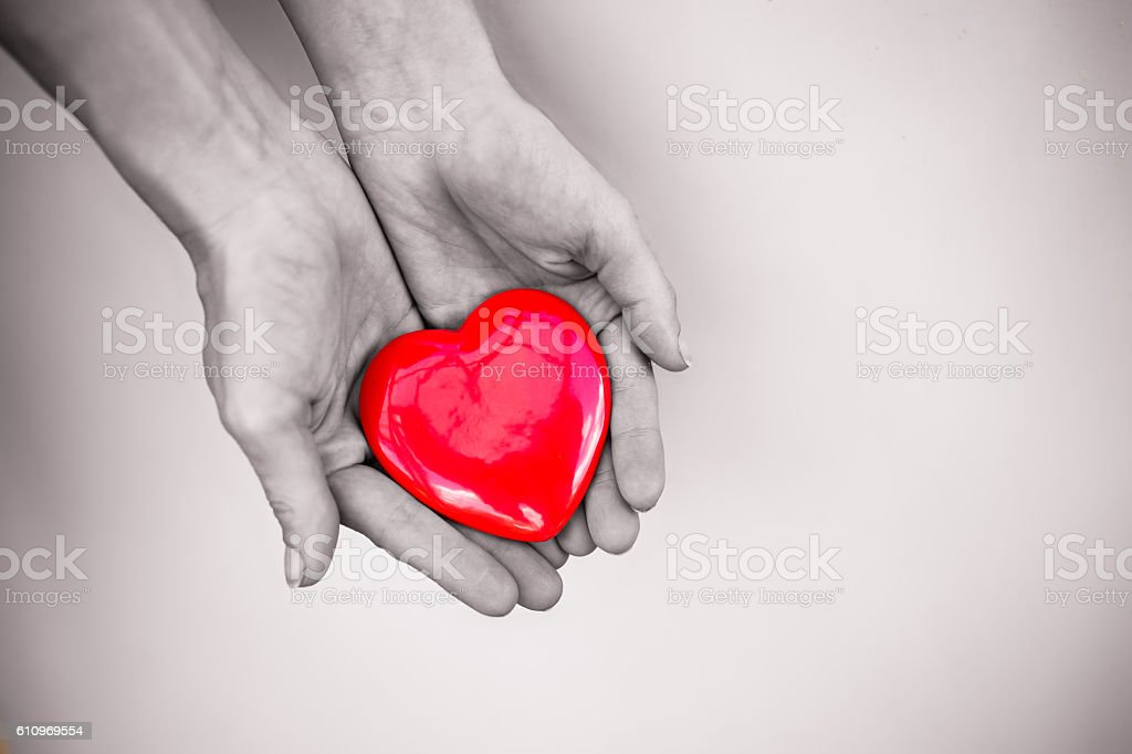 Hand holding heart stock photo