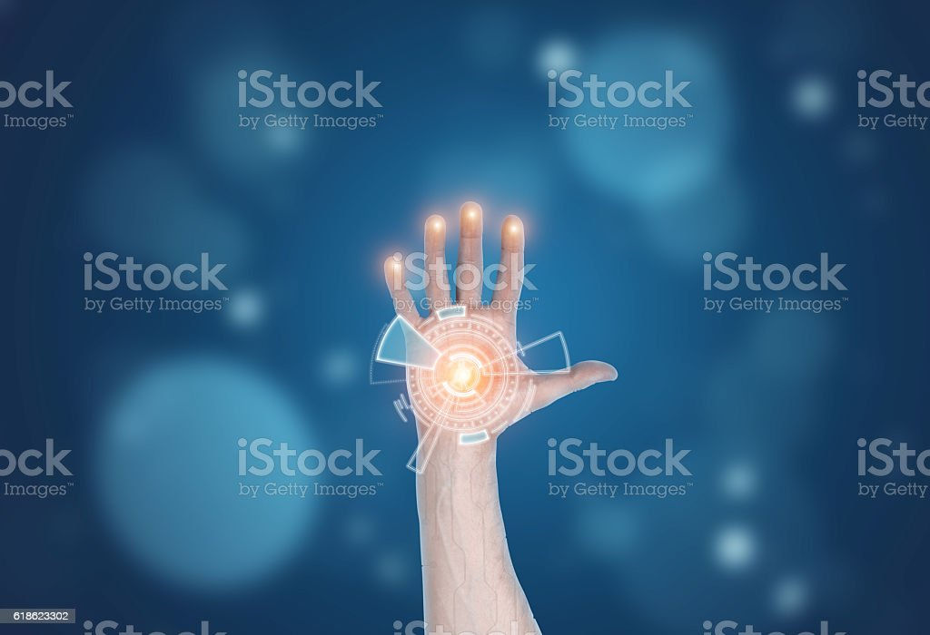 Hand holding hologram of digital circuitry stock photo