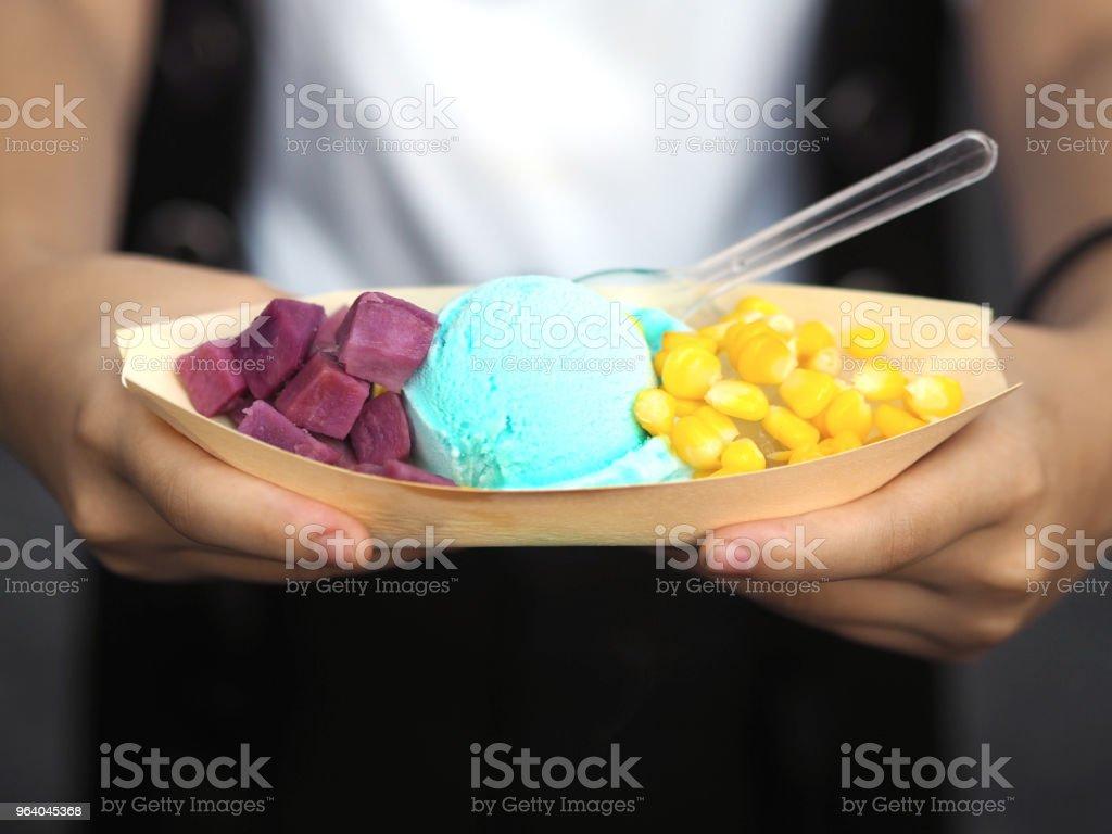 Hand holding homemade ice cream - Royalty-free Blue Stock Photo