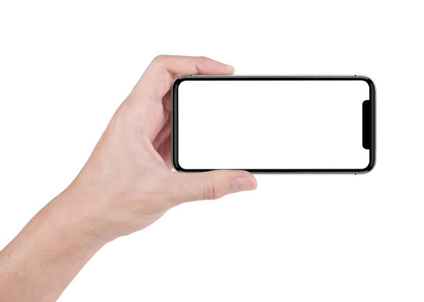 hand holding horizontal the black smartphone with white screen. stock photo