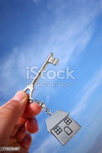 istock Hand holding house keys 175228487
