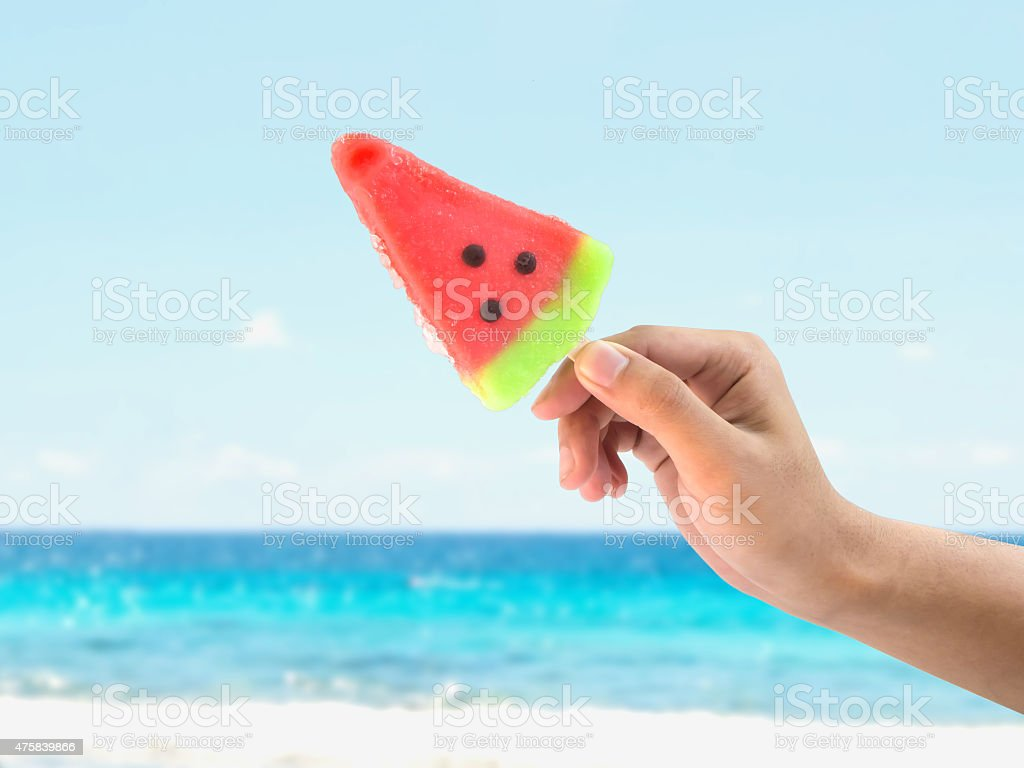 Hand holding ice cream watermelon shape stock photo