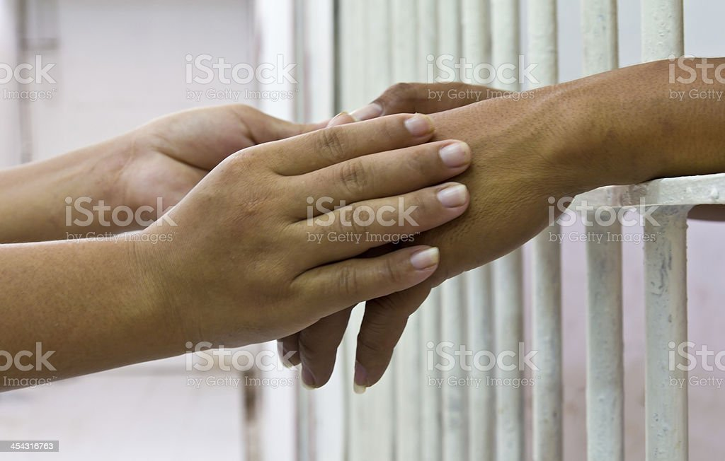 Hand holding in prison bars. royalty-free stock photo