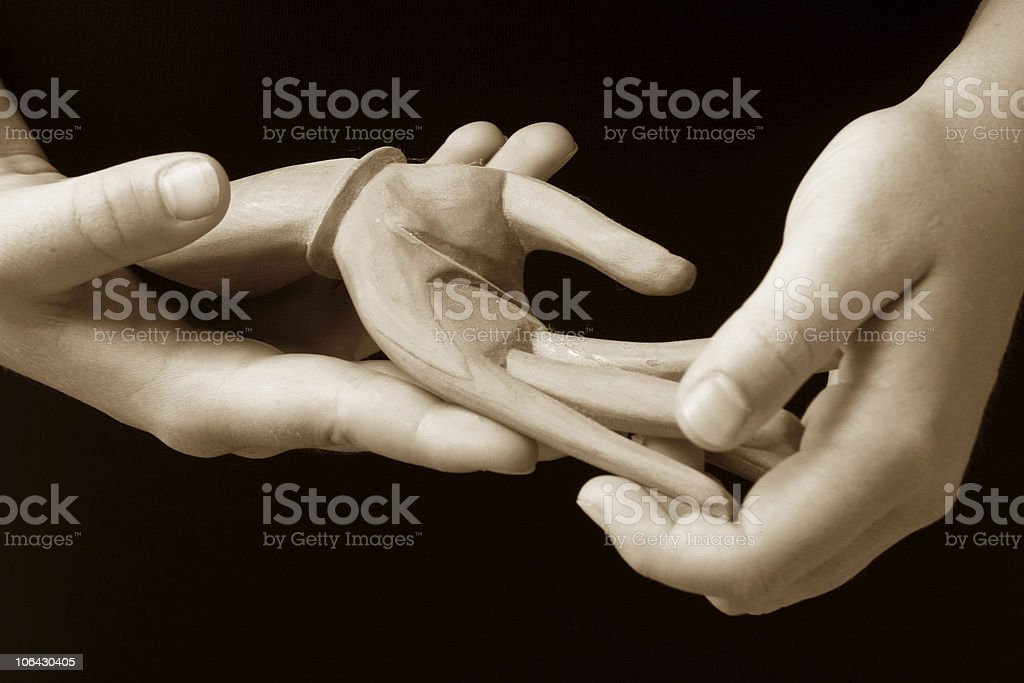 hand holding in sepia royalty-free stock photo