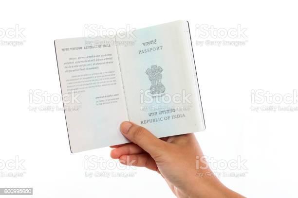 Hand holding indian passport open against white background picture id600995650?b=1&k=6&m=600995650&s=612x612&h=qrtjigbedpmgne4zbicofsqisquj3lir8mpvs5cbzto=