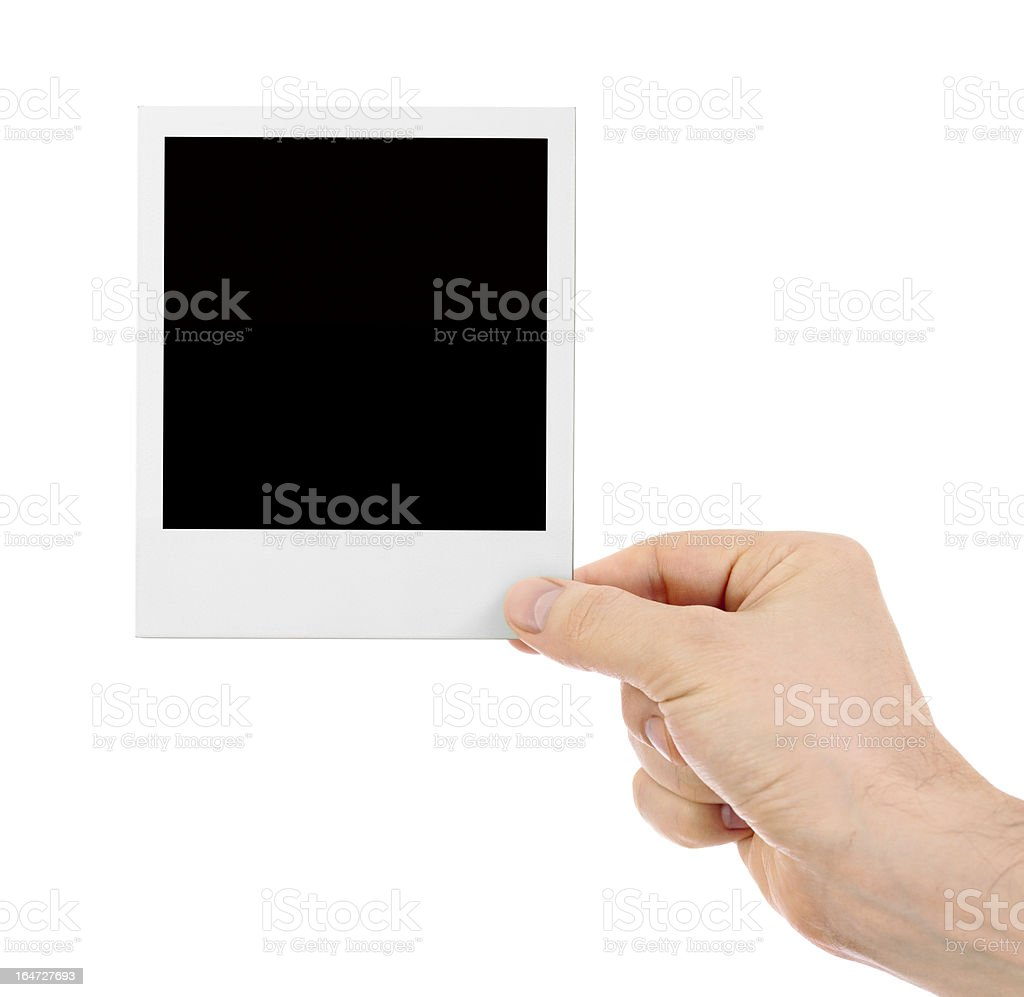 Hand holding instant shot frame isolated royalty-free stock photo