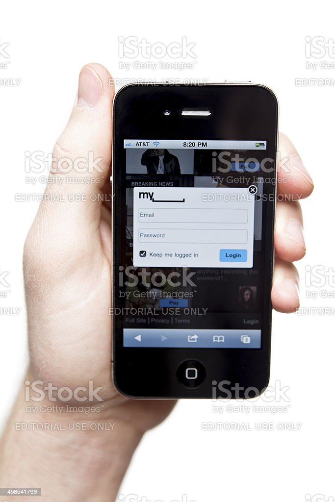 Hand holding iPhone 4 with Myspace on the screen. royalty-free stock photo