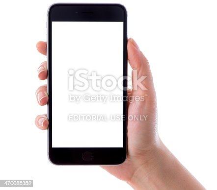 istock Hand holding iPhone 6 Plus on white background 470085352