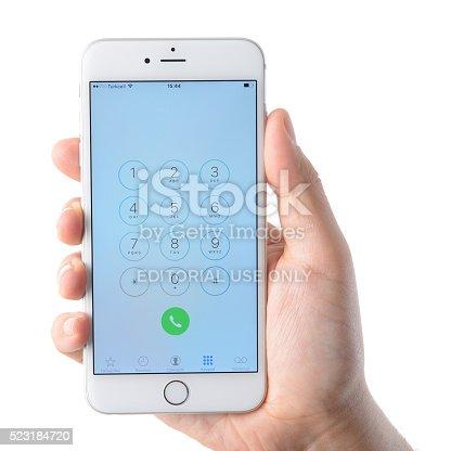istock Hand holding iPhone 6 Plus 523184720