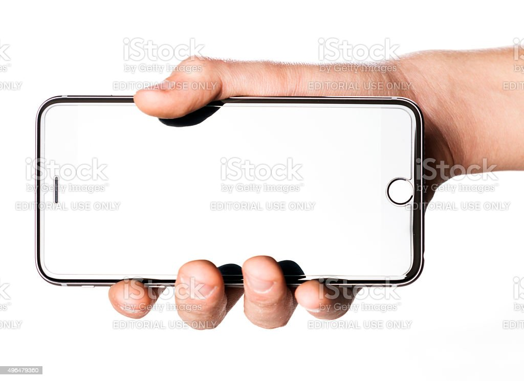 Hand holding iPhone 6s Plus on white background stock photo