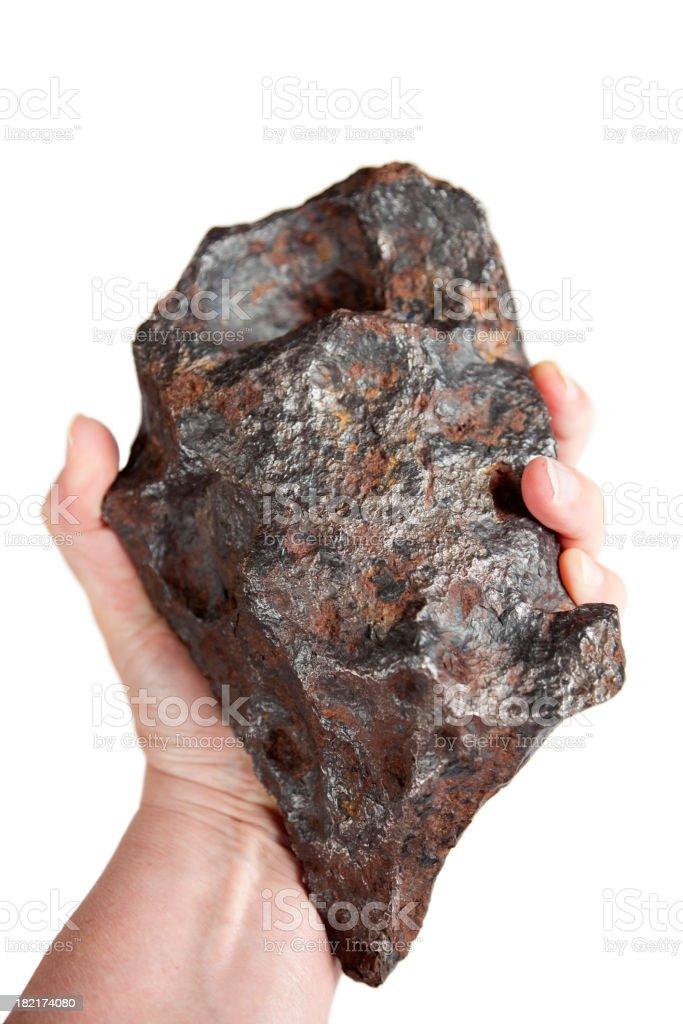 Hand Holding Iron Canyon Diablo Meteorite, with Rust stock photo