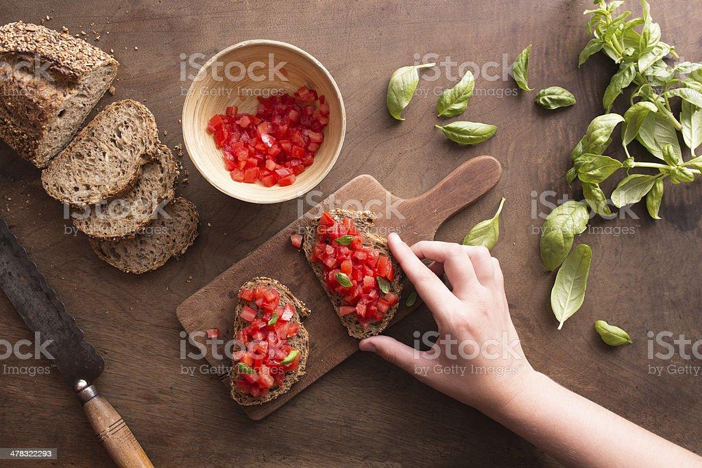Hand holding Italian bruschetta royalty-free stock photo