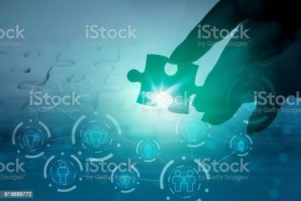 Hand holding jigsaw piece with background of teamwork picture id915689772?b=1&k=6&m=915689772&s=612x612&h=sdt8q0e9ymplsqsqq7v4bjyoqd0bfqc3nsrqe1lqd5i=