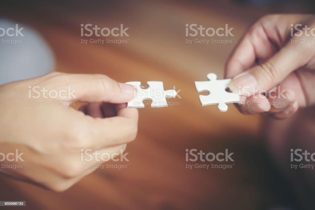 Hand Holding Jigsaw Puzzles Business Partnership Concept