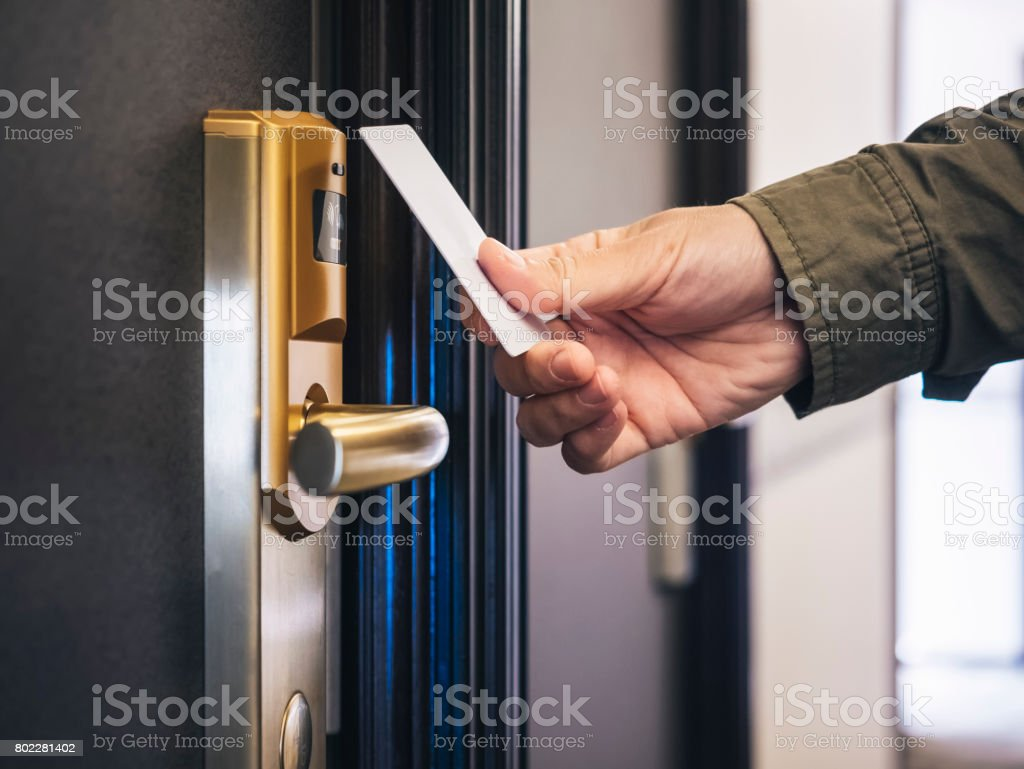 Hand Holding Key card Hotel room access stock photo
