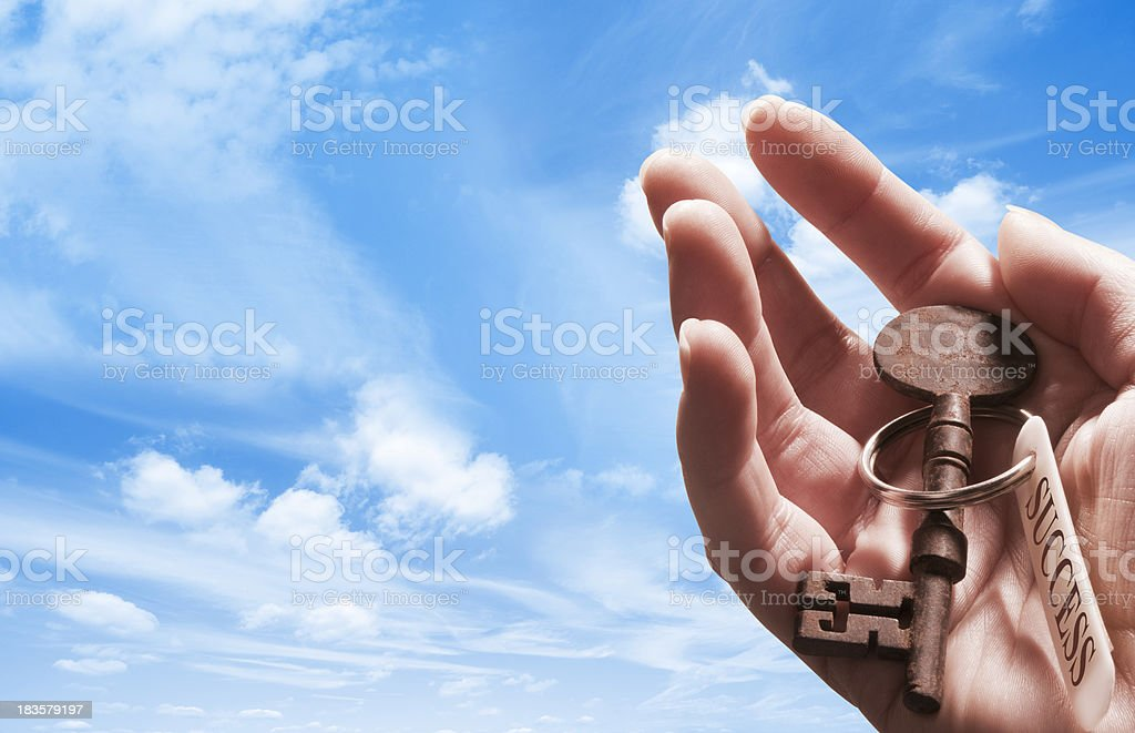Hand holding key with success written on key tag royalty-free stock photo
