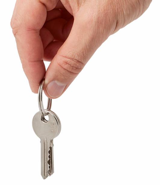 hand holding keys stock photo
