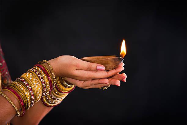 hand holding lantern during diwali festival of lights stock photo