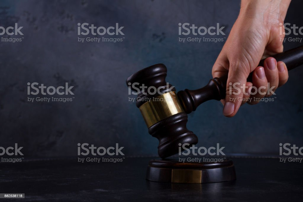 Hand holding law gavel stock photo