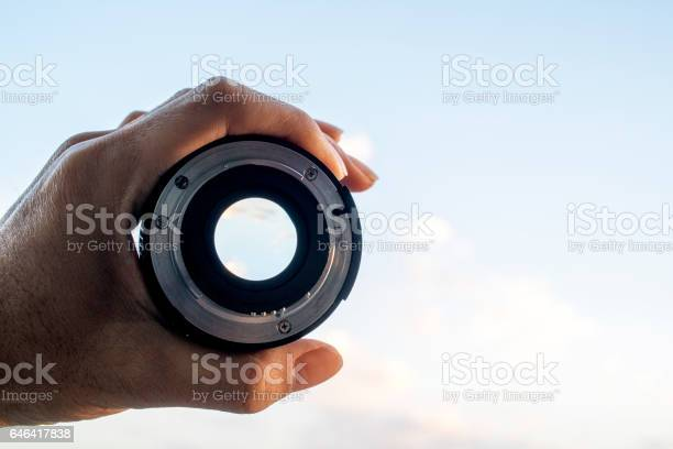 Hand holding lens looking at sky picture id646417838?b=1&k=6&m=646417838&s=612x612&h=lm1nwfcx96ggpnshydbxp6oxfevmidh0brqwlbgywwa=