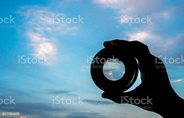 Hand holding lens watching cloudscape picture id611784426?b=1&k=6&m=611784426&s=612x612&h=n4t1i18ahtidp4izhkimhvnxlqlgc8rvhorwtfm6jbm=