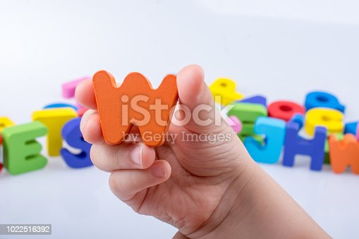 istock Hand holding Letter cube  W of  Alphabet 1022516392