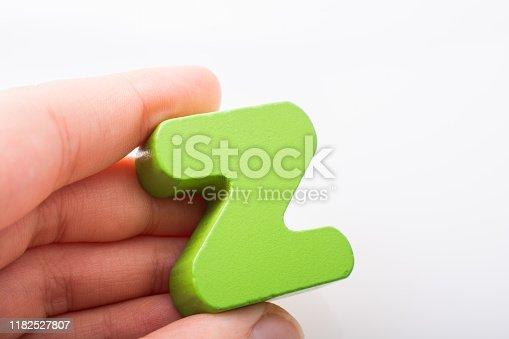 istock Hand holding Letter cube  Z of  Alphabet 1182527807
