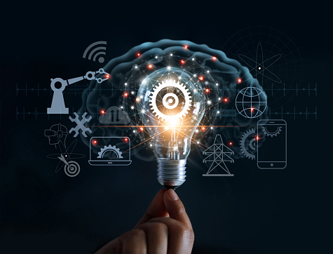 istock Hand holding light bulb and cog inside and innovation icon network connection on brain background, innovative technology in science and industrial concept 962093478