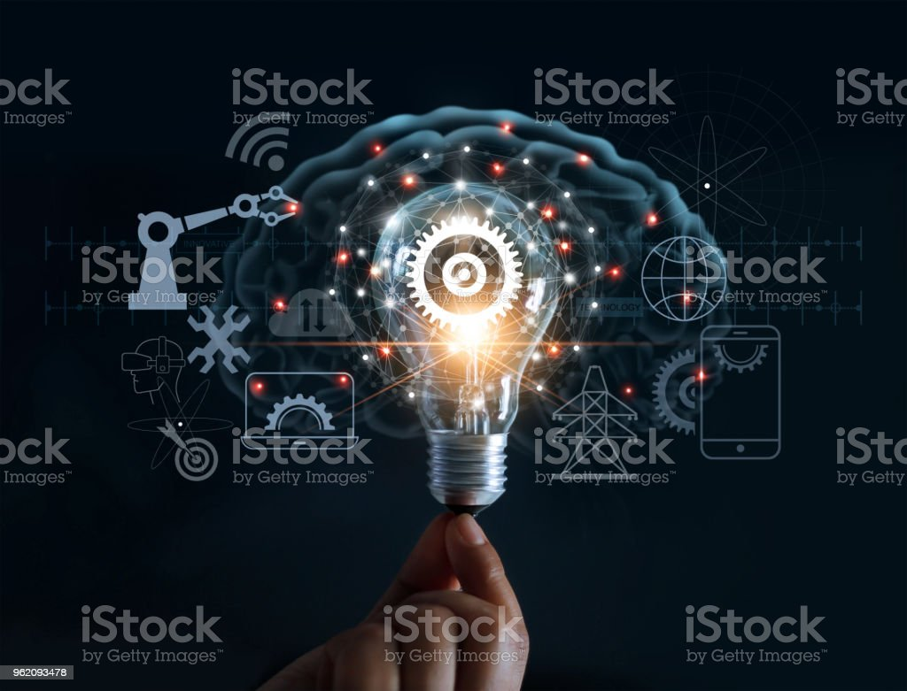 Hand holding light bulb and cog inside and innovation icon network connection on brain background, innovative technology in science and industrial concept stock photo