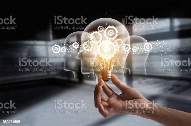 Hand holding light bulb and cog inside idea and imagination creative picture id962071696?b=1&k=6&m=962071696&s=612x612&h=s9oejnjojiodakbwv3za4rjzv 3zbekvswankjrtlq4=